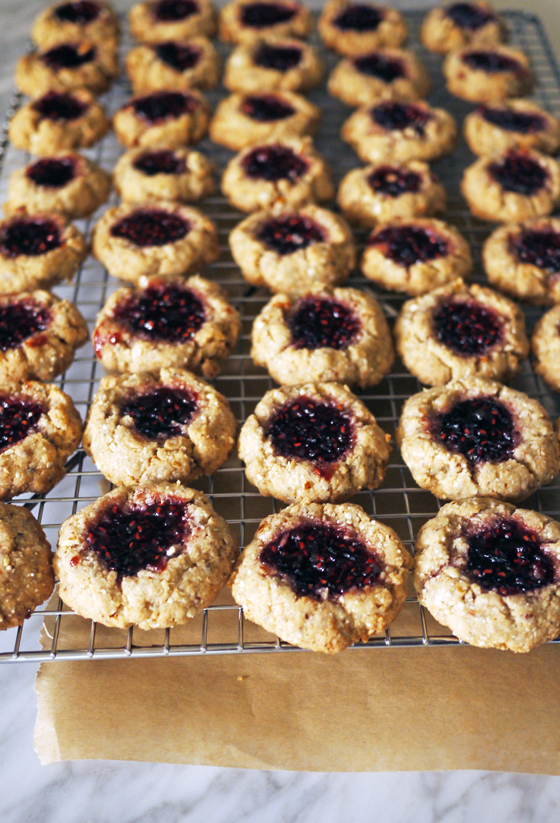 Coconut Almond Raspberry Thumbprint Cookies: The most delicious vegan cookie recipe. Even non-vegans will love this! | Stacie Billis